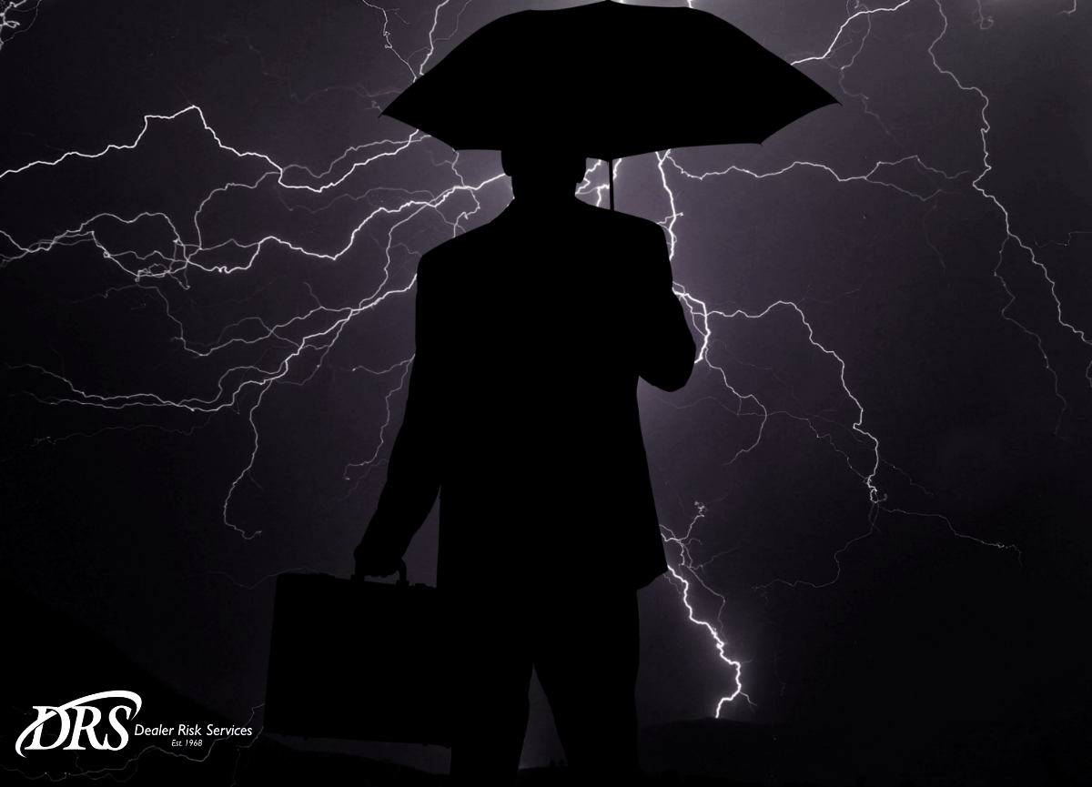 Commercial Umbrella Coverage: Business Man Holding Umbrella, Lightning
